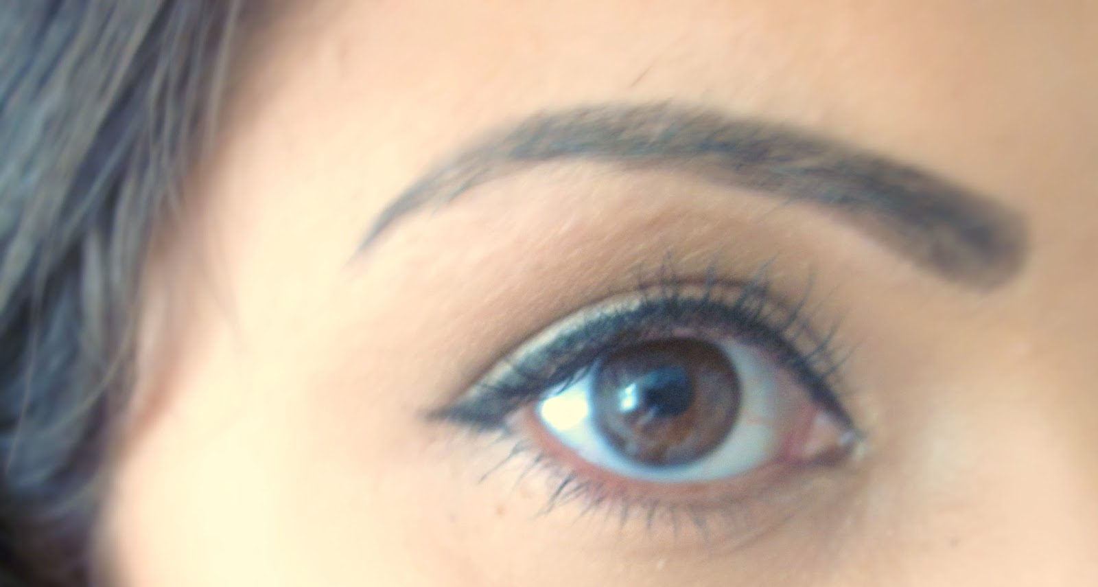Winged eyeliner using Benefit They're Real Push Up Liner
