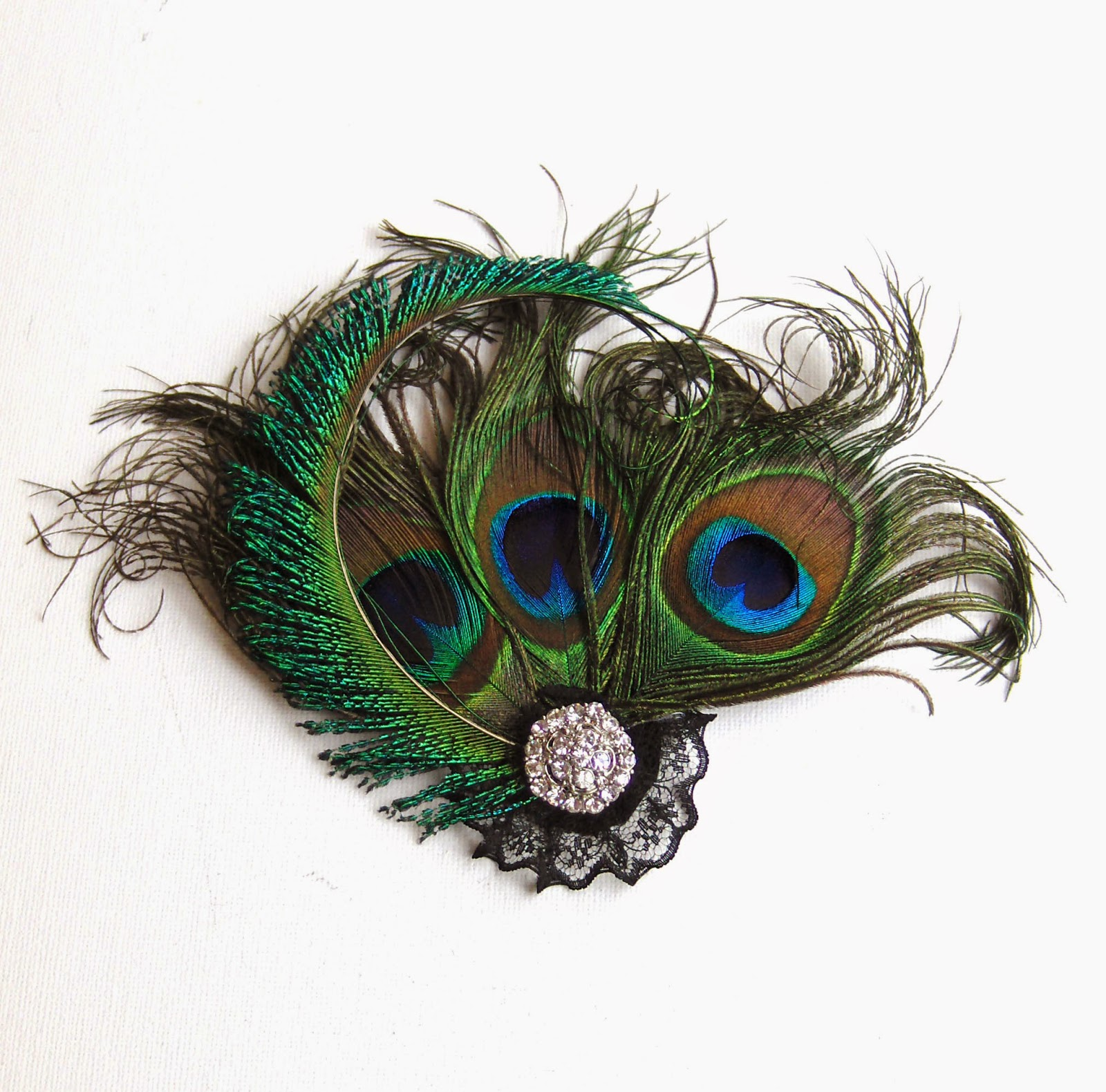 https://www.etsy.com/uk/listing/185174537/peacock-feather-rhinestone-fascinator-uk?ref=related-0