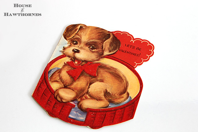 Vintage Valentine card with cute puppy in a bed