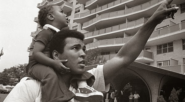 Muhammad Ali holds his son in 1974 in The Trials of Muhammad Ali.
