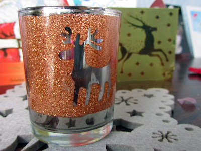 candle holder and card with a deer
