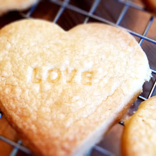 Heart shaped shortbread biscuit with love stamp