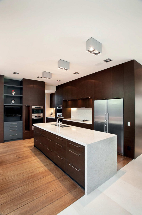 Photo of large modern kitchen with dark brown burniture