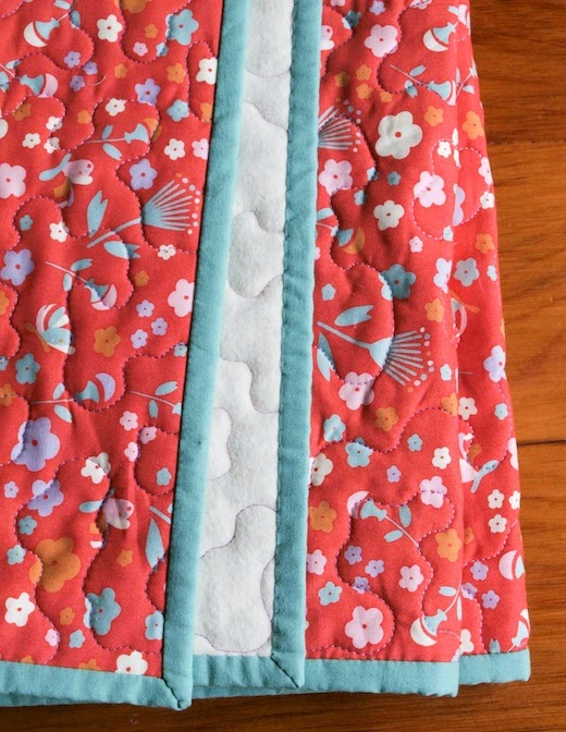 Floral whole-cloth organic baby quilt