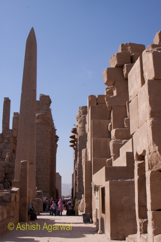 Tourists inside the Karnak temple, with the Obelisk to one side
