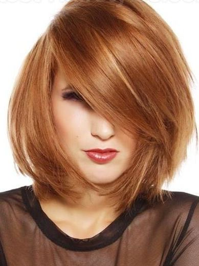 Medium layered rounded bob with a heavy side swept fringe