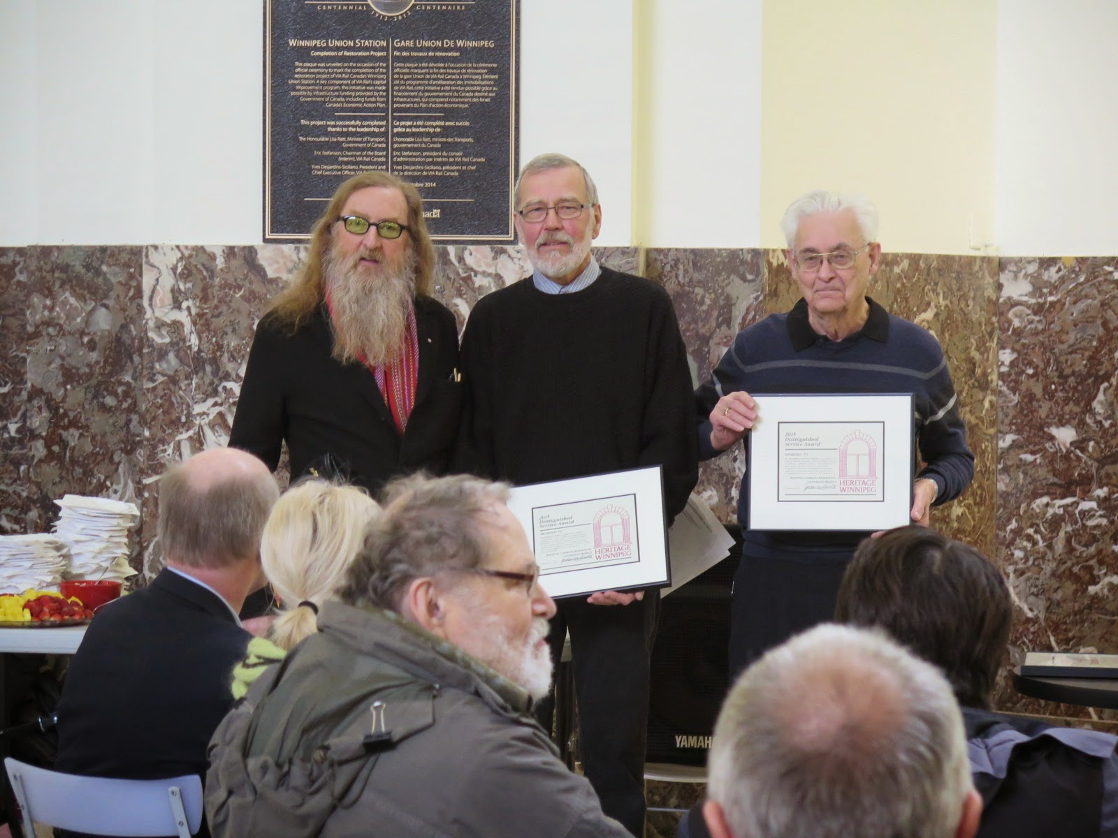 Bob Clarkson and Roger Gateson accept awards on behalf of the church communities