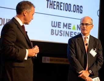 Chairman of Swiss Re America Holding Corporation, Philip K. Ryan, is seen here (on the right) talking at the launch of RE100, an initiative whose backers pledge to derive 100% of their company's power from renewable sources by 2020. The launch was part of Climate Week NYC (Sept. 22-28).  (Credit: insideclimatenews.org) Click to enlarge.