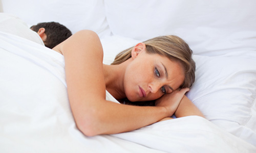 5 Signs She is Secretly Unhappy in Your Relationship,woman sleep in bed sad don't have sex