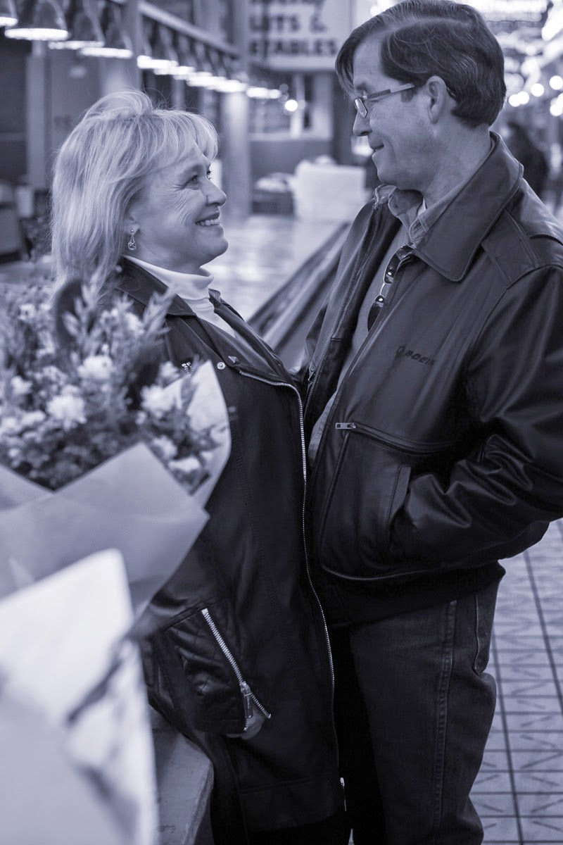 James and Joan with flowers at Pike Place Market - Patricia Stimac, Seattle Wedding Officiant