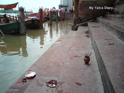 Elements of faith at the Yamuna River Ghat, Mathura