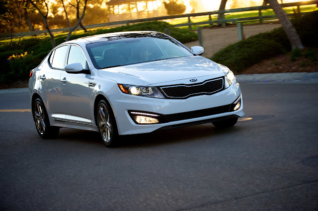 front 3/4 driving shot of white 2013 Kia Optima SX