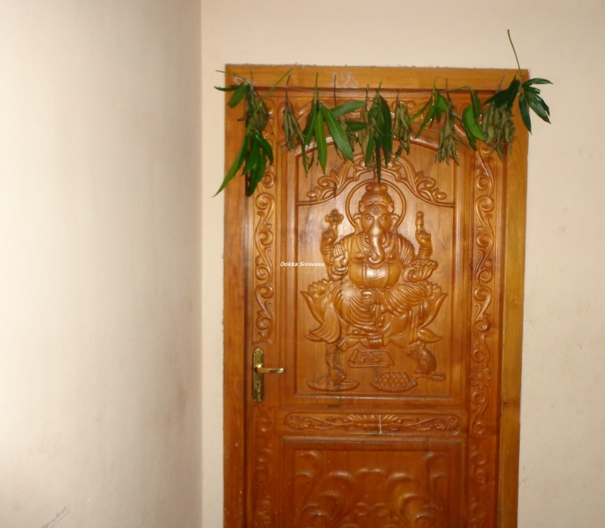 Heritage of india lord ganesha wooden door carving photograph for Front door design in india