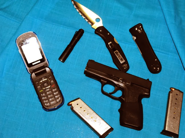Gun, knives reload, light and phone