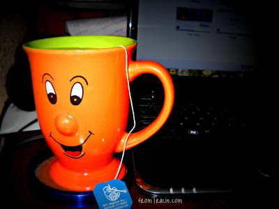 orange mug with smiling face