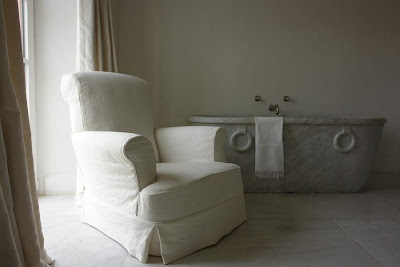 "Garnier's bathing room, marble tub, ""Chateau"" custom chair available at Garnier Interiors image via Garnier (be) website, as seen on linenandlavender.net"