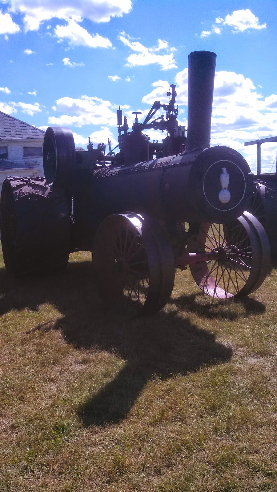 Another neat old tractor that looks halfways like a train engine