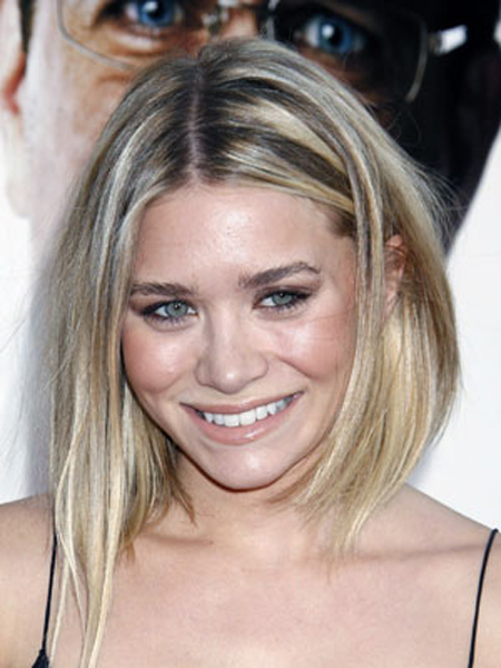 Ashley Olsen's bodified bob is tucked back on the side and sports long, piece-y ends through the front.