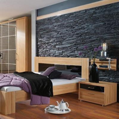 paredes de piedra en el dormitorio