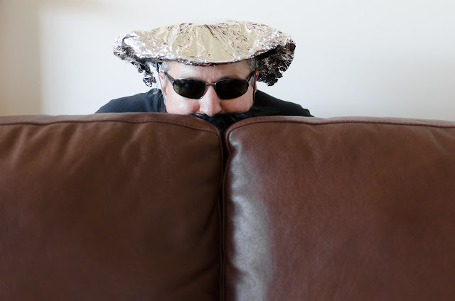 hiding behind the couch whilst wearing alfoil hat