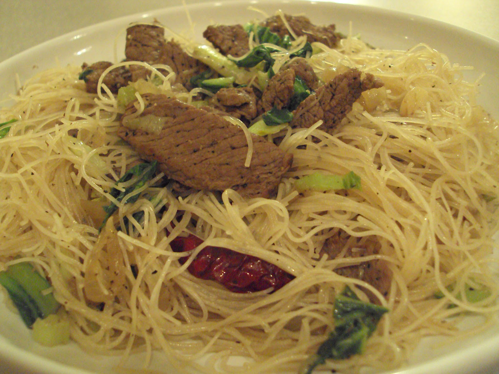 ... with Rice flour noodles (Bee Hoon) with green vegetables is a home