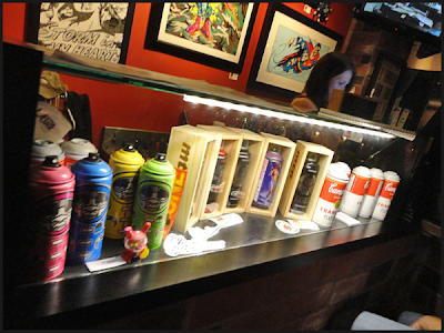 Custom spray paint cans at Extra Large Gallery