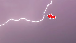A screenshot from the video where the lightning bolts strikes.