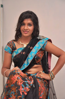 Gajamugan Movie Actress Iduppu Madippu Stills