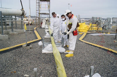 Hanford tank farm workers use Geiger counters to measure radiation.