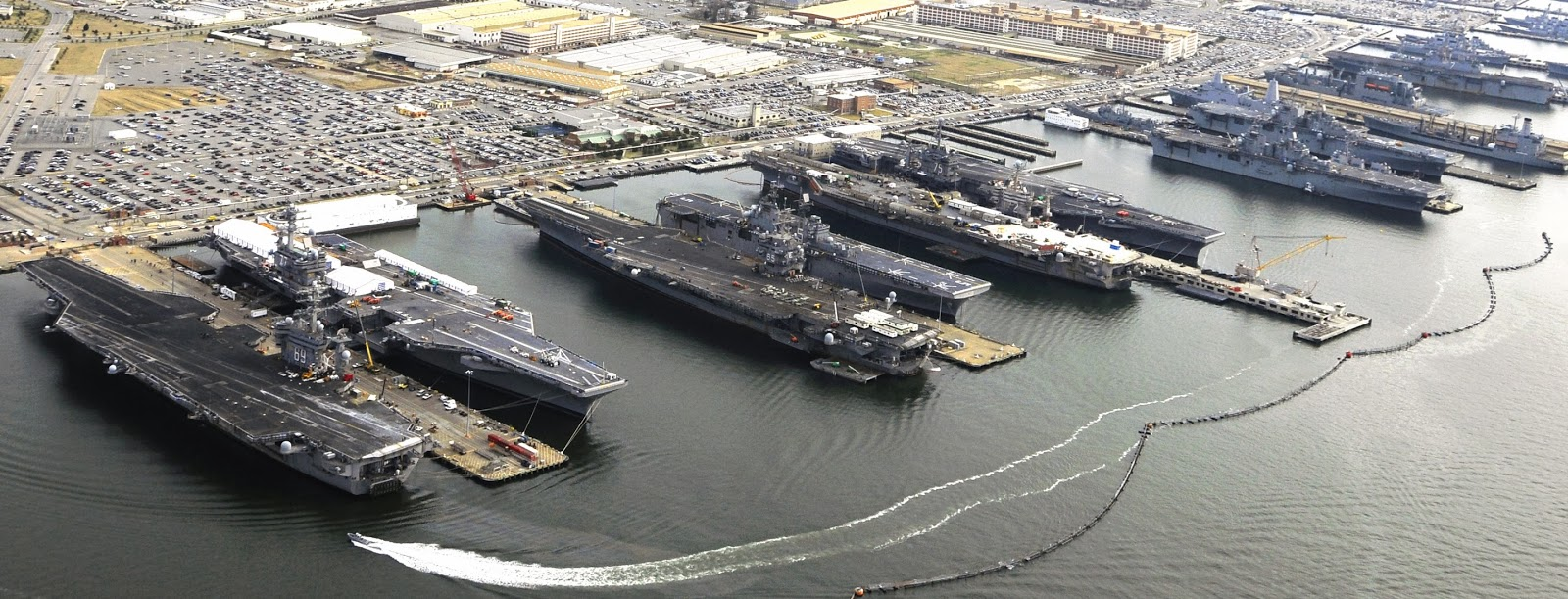Aircraft carriers docked at Norfolk pier