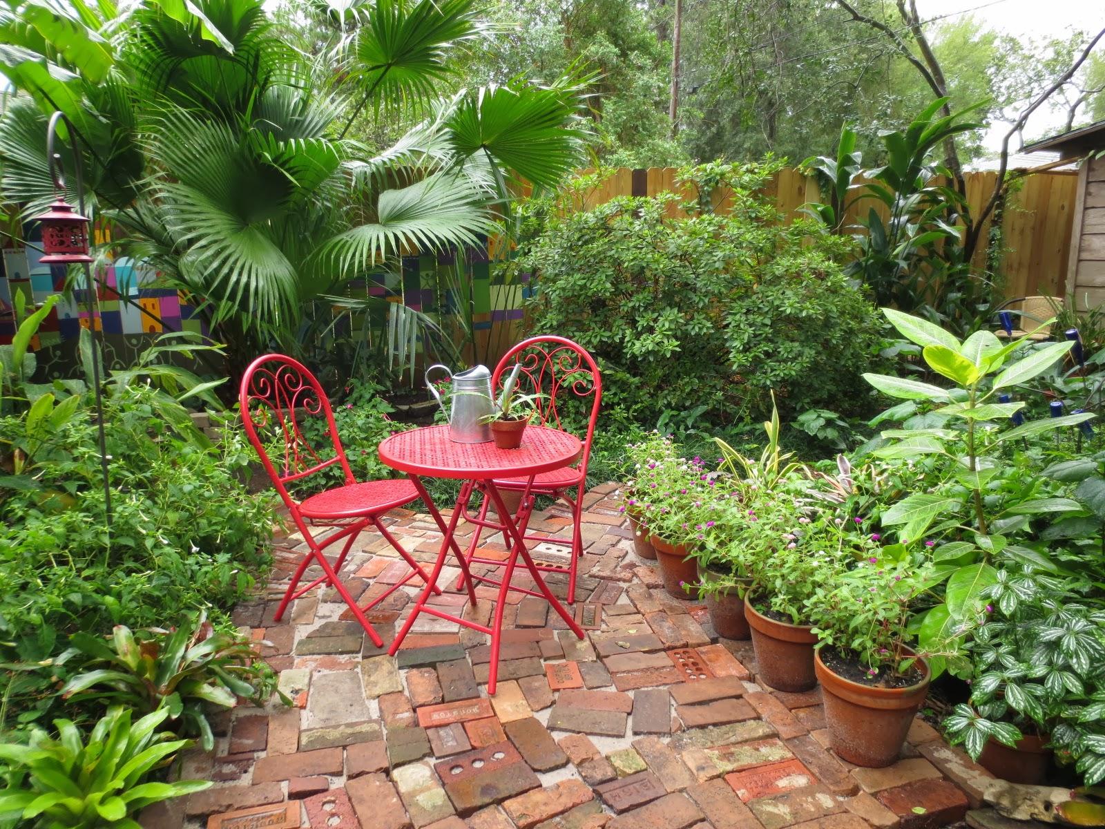 Tropical texana antique brick courtyard comes to life for 10 plants for courtyard gardens design
