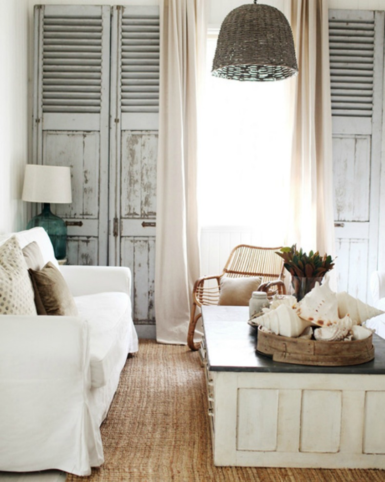 whitewash wood, slipcovers, wicker and seashells in this coastal cottage room
