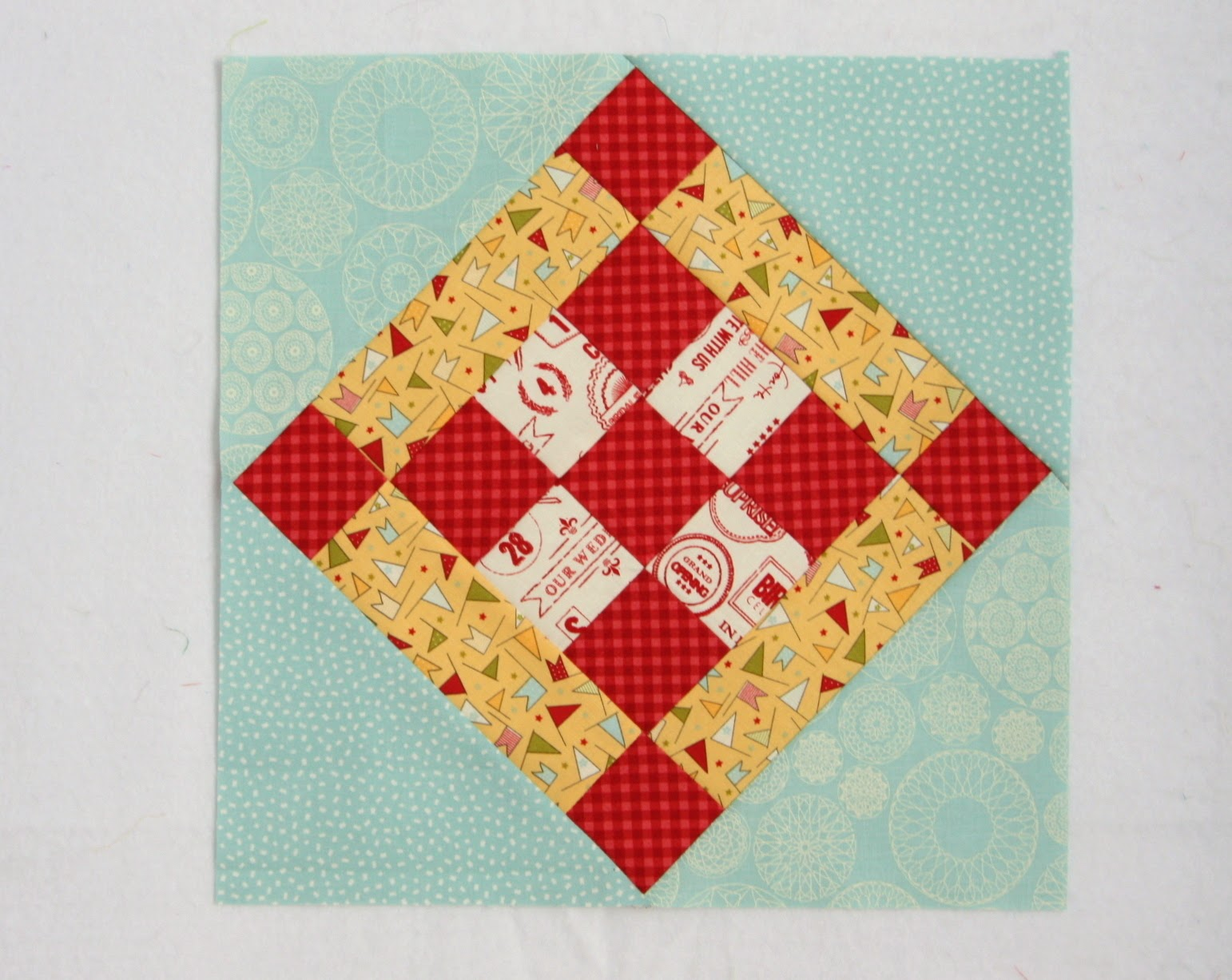 Free quilt block pattern from Aurifil's 2014 Block of the Month