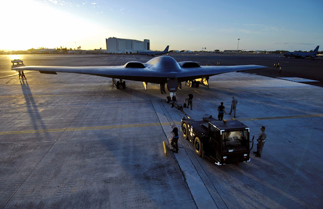 A B-2 Spirit is towed to a parking spot Feb. 12 at Hickam Air Force Base, Hawaii