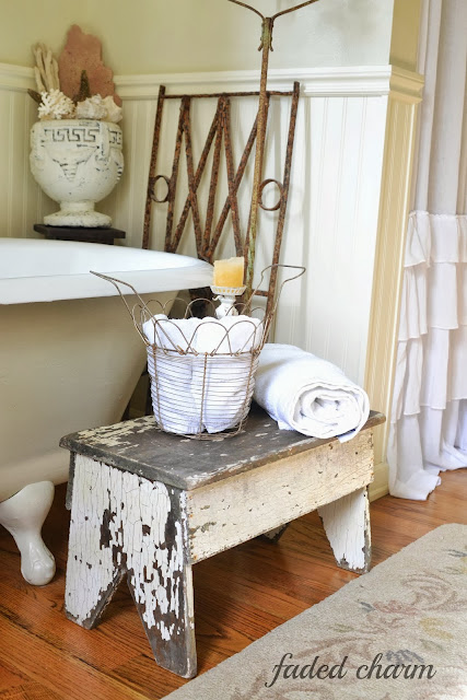 Chippy bench in the bathroom / A beautifully reclaimed bathroom tour by Faded Charm, featured on http://www.ilovethatjunk.com