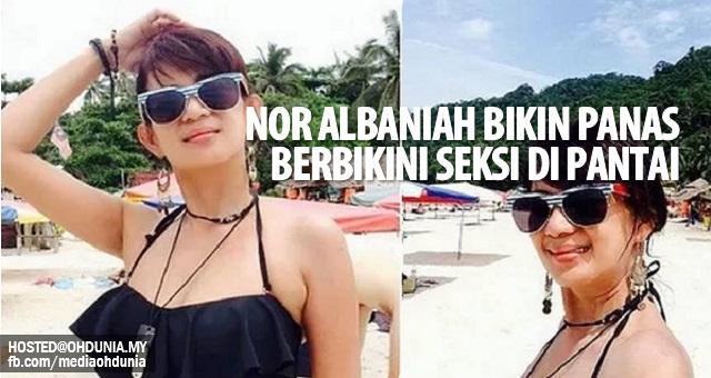 Di usia senja Nor Albaniah bikin panas, berbikini seksi di tepian pantai