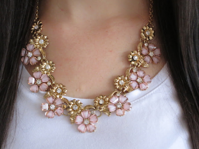 A floral and gold necklace with sparkles