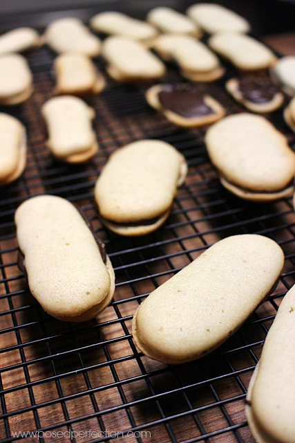 Homemade Mint Milano Cookies getting frosted.