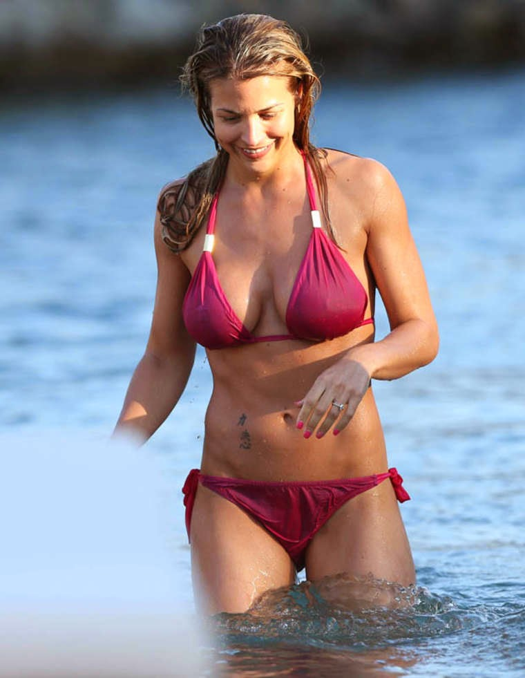 Gemma Atkinson squeezes her perfect Red Bikini shapes in Dominican Republic
