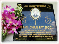 Marbled plaque covering the niche of the late Clare Chan