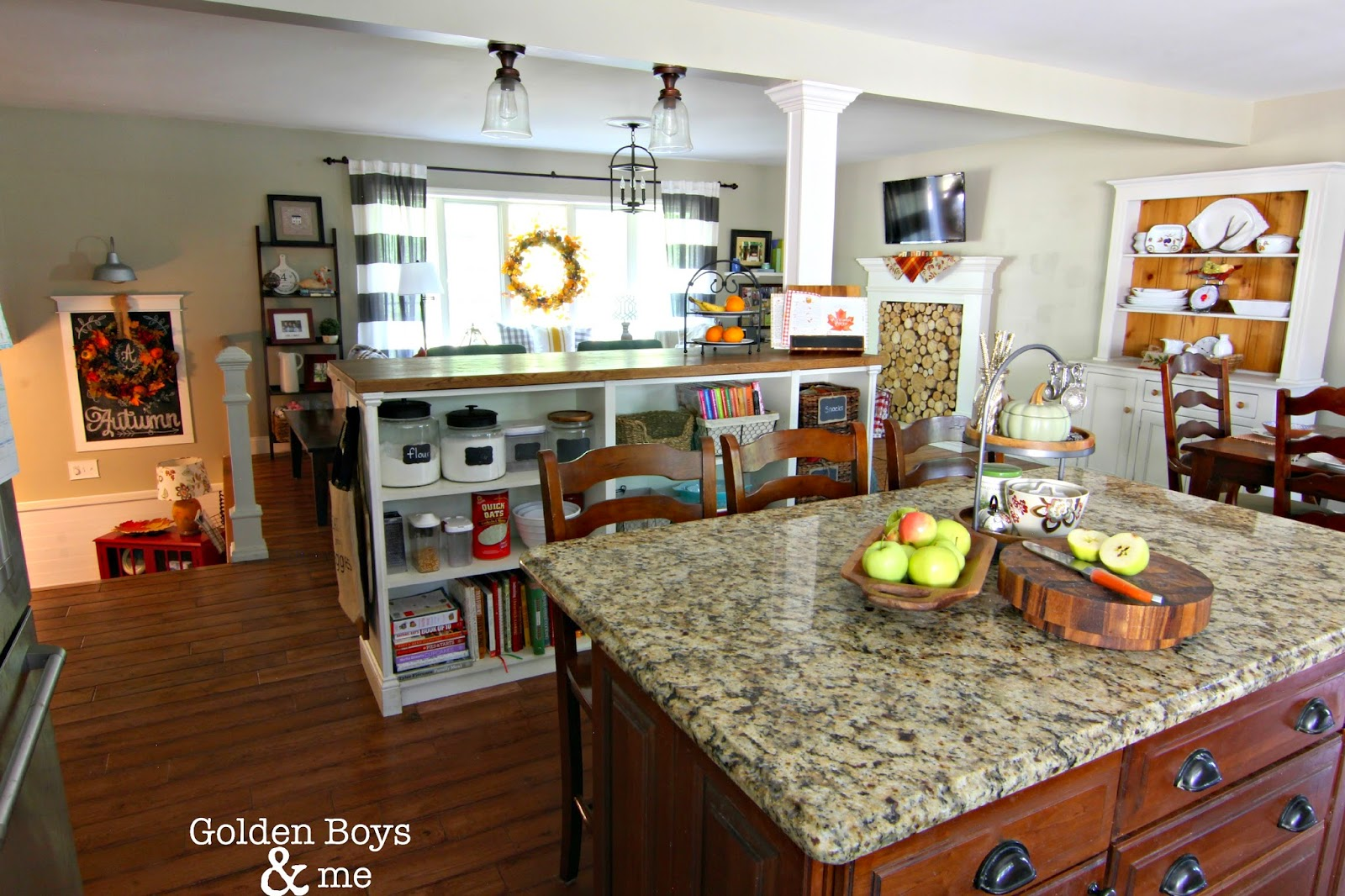Open concept living/kitchen/dining room in a split level home with fall decor-www.goldenboysandme.com