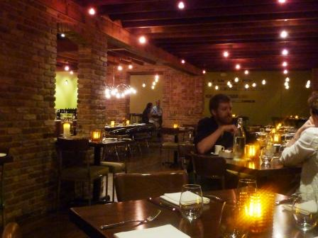 exposed brick walls and wood beam ceilings give the room warmth there are some interesting half circle booths on one side of the room which i am eager to - 8407 Kitchen Bar