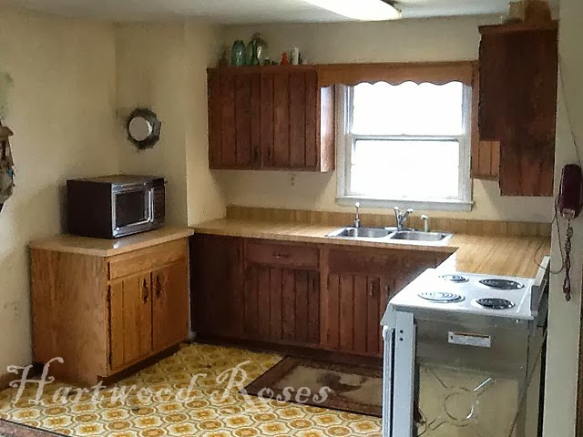 to help with the traffic flow my brother moved the cabinet that was beside the electric stove opening up a larger area to pass through the kitchen to the     hartwood roses  transforming kitchen cabinets with chalk paint  rh   hartwoodroses blogspot com