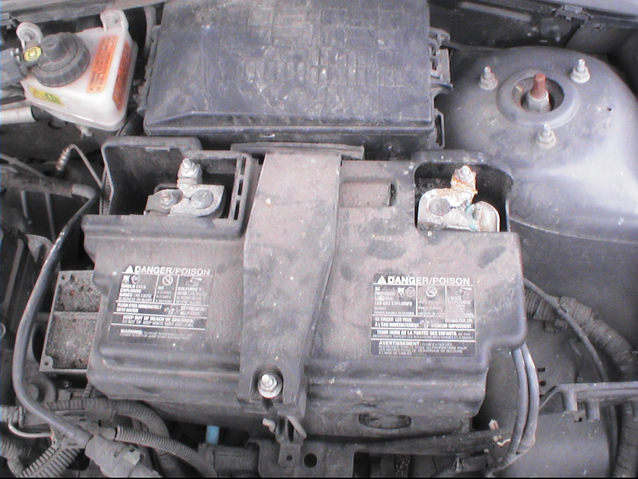 Fh auto repair how to change the battery on a 2000 2007 ford focus lift the hood and locate the battery sciox Image collections
