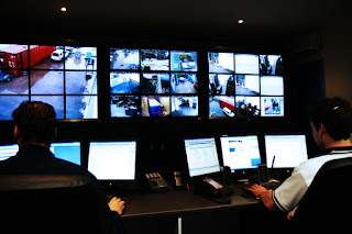 Loss Prevention room with multiple televisions monitors security cameras