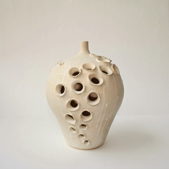 https://www.etsy.com/listing/158236289/white-ceramic-vase-dramatically-pierced?ref=favs_view_10