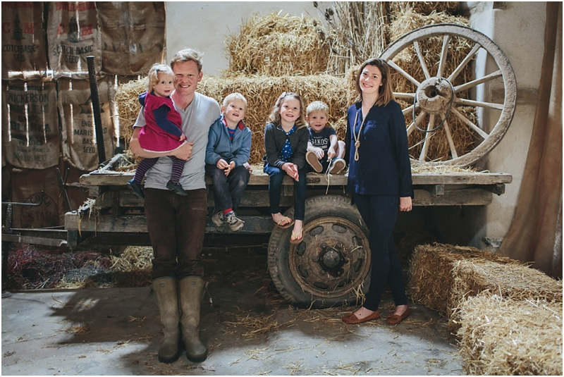 The Ursell family in Windout Barn, sitting on the trailer