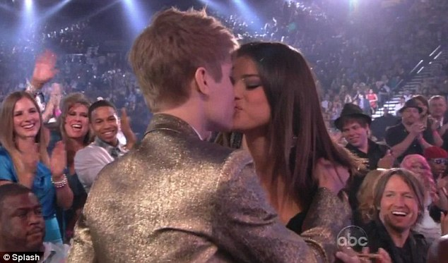 No more sneaking around! Selena Gomez congratulates Justin Bieber with a big kiss as he scoops SIX Billboard awards