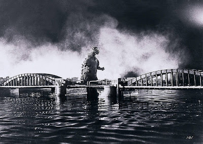 Godzilla near a bridge in Gojira