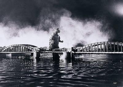Godzilla near a bridge in Gojira